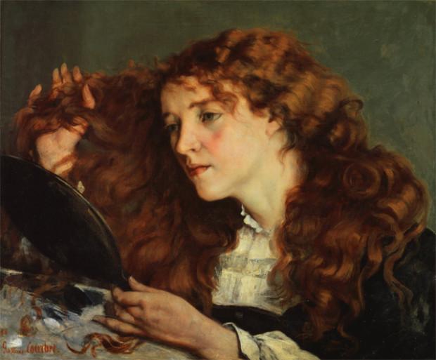 女性が鏡をのぞいている絵